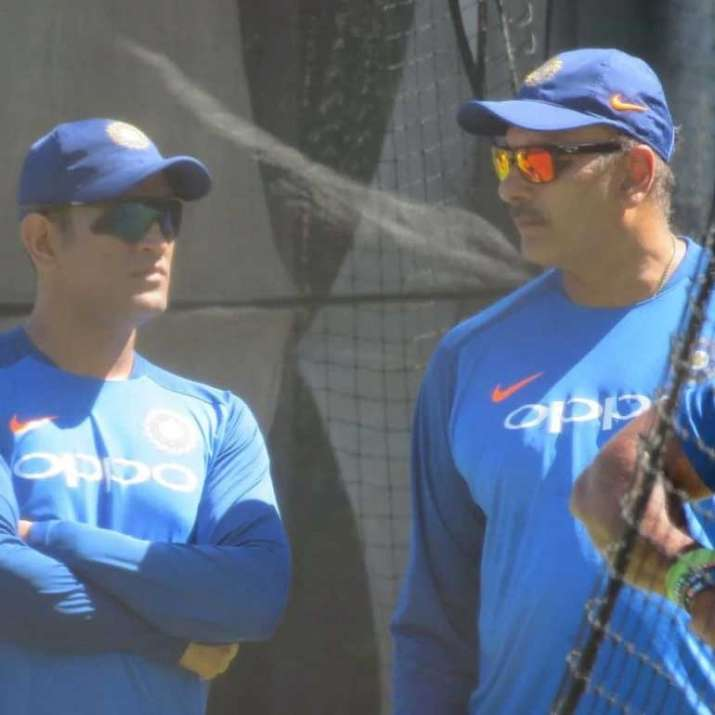India Tv - MS Dhoni and Ravi Shastri in a conversation.