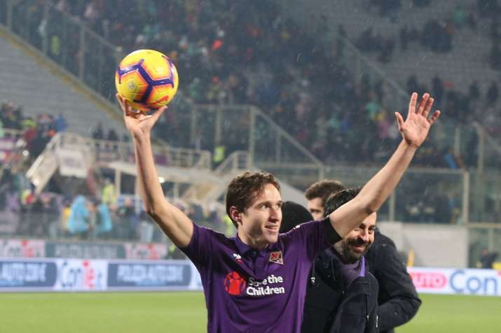 India Tv - Federico Chiesa holds the match ball after scoring a hat-trick