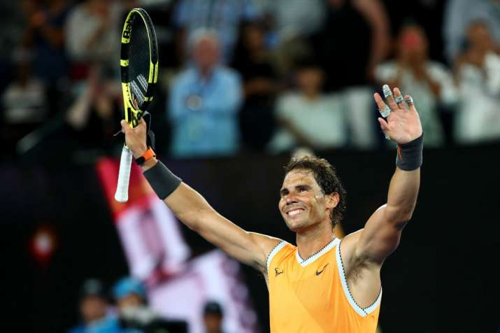 Australian Open: Rafael Nadal enters round three with easy win over Matthew Ebden