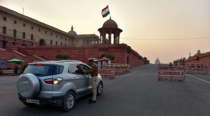 India Tv - A security jawan stops a vehicle for a check at Vijay Chowk on the eve of Republic Day parade in New Delhi.