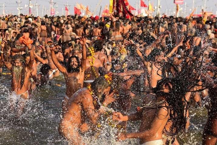 Naga Sadhus take holy dip in Ganga.