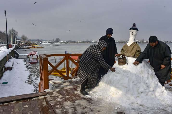 India Tv - People make a snow man after heavy snowfall, in Srinagar