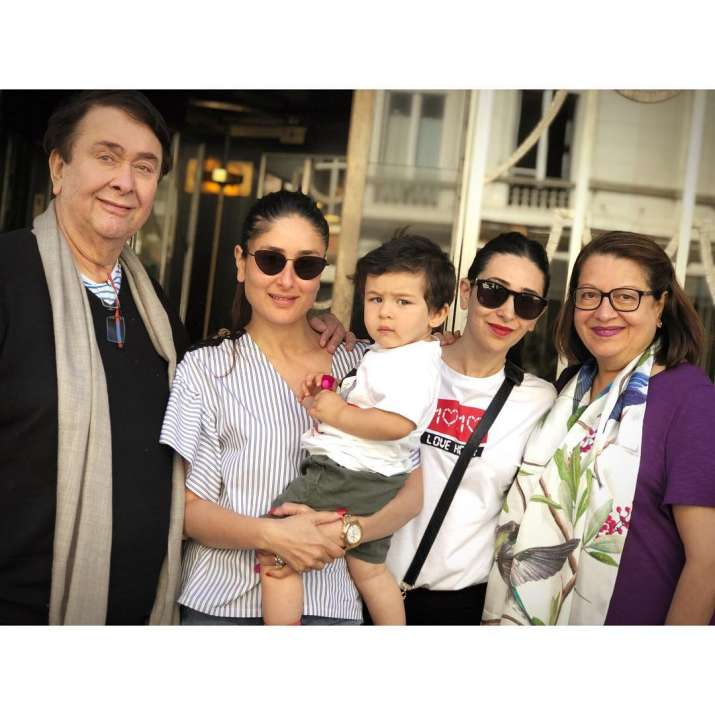 India Tv - Randhir Kapoor with his wife and Daughters Karisma Kapoor and Kareena Kapoor Kahn along with little Taimur