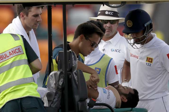 India Tv - Dimuth Karunaratne, second right, lays on a buggy and is attended to by medical personnel.