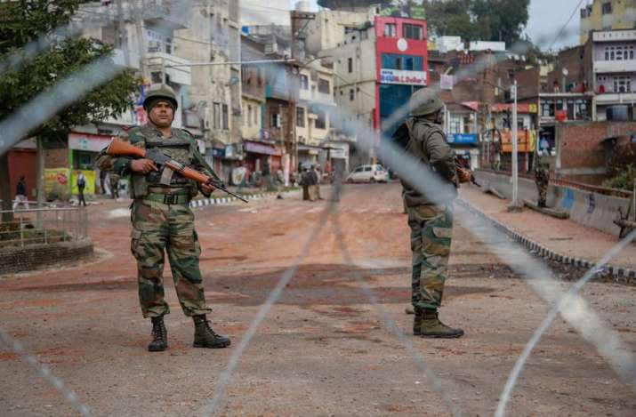 Army personnel stand guard at Gujjar Nagar area during a