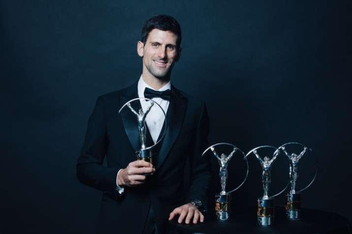 India Tv - Djokovic poses with the Laureus Sports awards