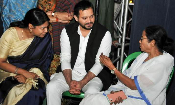 India Tv - West Bengal Chief Minister Mamata Banerjee with DMK MP Kanimozhi (L) and RJD leader Tejashwi Yadav at Banerjee's sit-in over the CBI attempt's to question the Kolkata Police Commssioner in connection with chit funds scam, in Kolkata