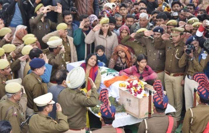 India Tv - Bereaved family members of CRPF martyr Pradeep Kumar, who lost his life in Pulwama terror attack, pay last respects in Kannauj