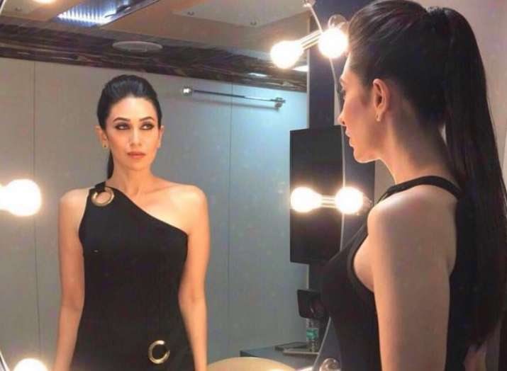 Don't miss being in front of camera, says Karisma Kapoor