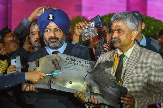 Indian Air Force officials show sections of an exploded