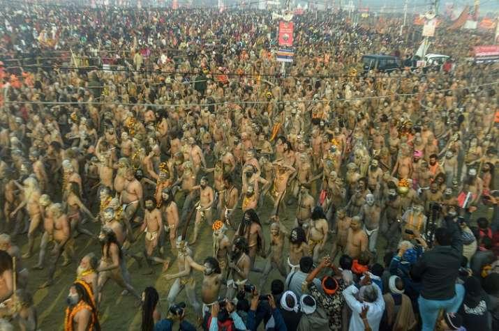 India Tv - Naga Sadhus arrive to take a holy dip at Sangam on the auspicious 'Mauni Amavasya' day during the Kumbh Mela