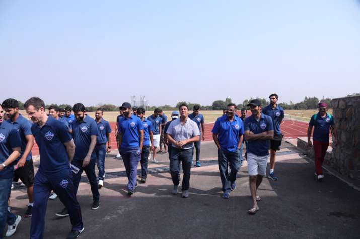 India Tv - Ishant Sharma and other DC players walk during the camp.