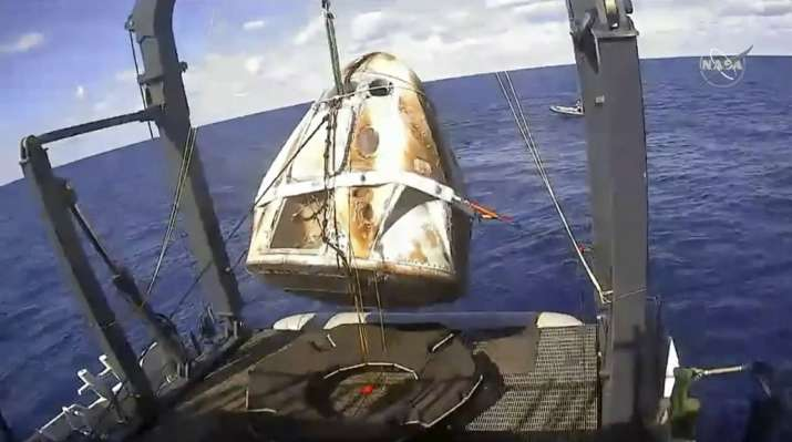 India Tv - SpaceX Crew Dragon capsule completes historic unmanned flight test with ocean splashdown