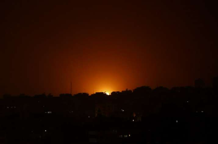An explosion caused by Israeli airstrikes is seen on Gaza