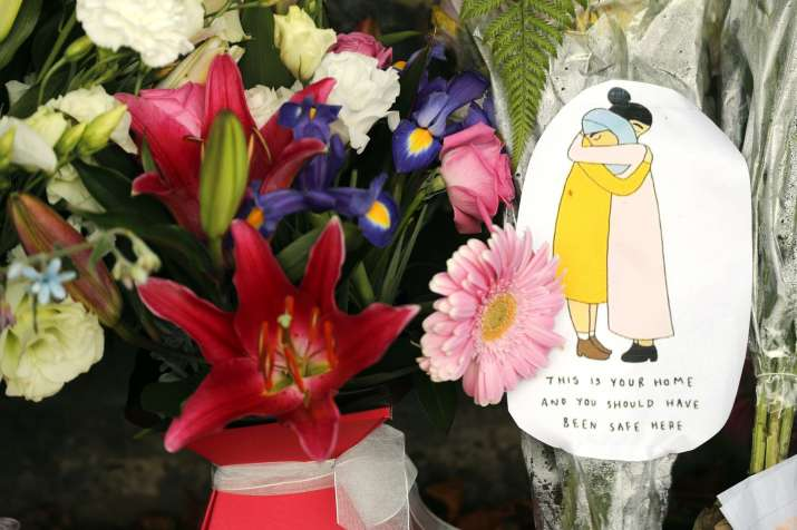 India Tv - A message card is placed at a collection of flowers left at the Botanical Gardens in Christchurch, New Zealand, Saturday, March 16, 2019.