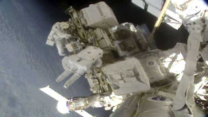 Spacewalking astronauts install better station batteries