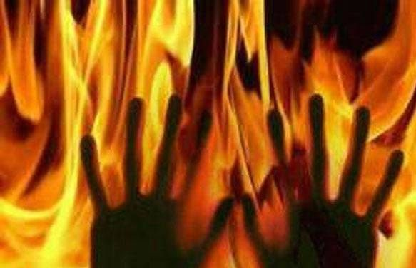 A manwas arrested for burning his wife to death.