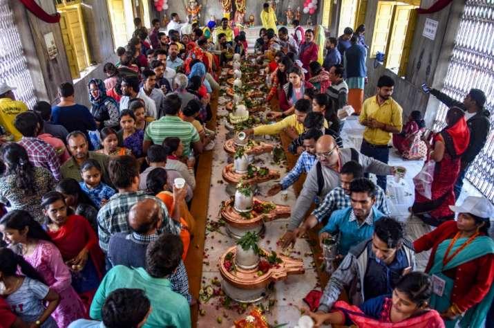 India Tv - Prayagraj: Devotees offer prayer at a temple on the occasion of 'Maha Shivaratri' festival during the ongoing Kumbh Mela, in Prayagraj (Allahabad), Monday, March 4, 2019.