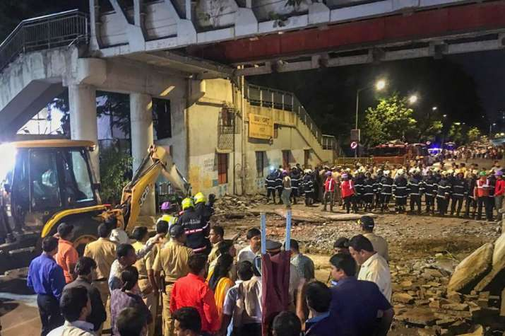 India Tv - Mumbai: Rescue work in progress after a foot overbridge near CSMT station collapsed