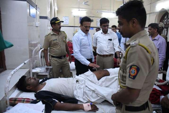 India Tv - Maharashtra Minister Girish Mahajan meeting the injured at GT Hospital