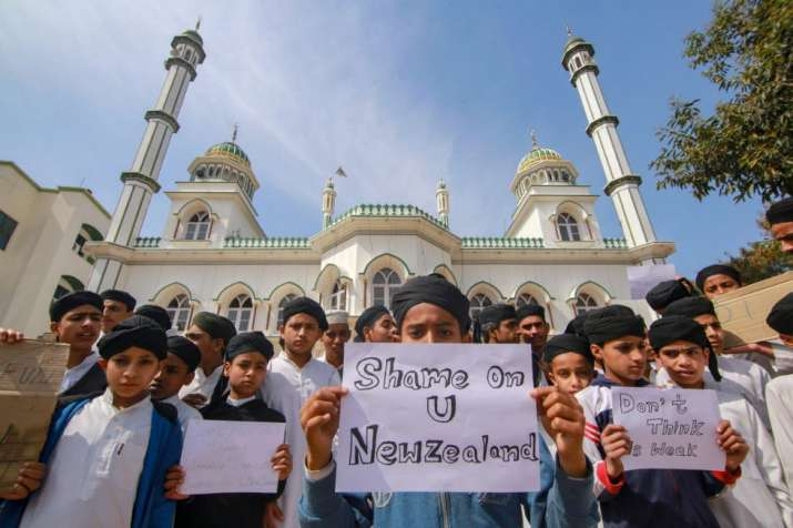 Jammu: Children hold placards to condemn the New Zealand mosque attack