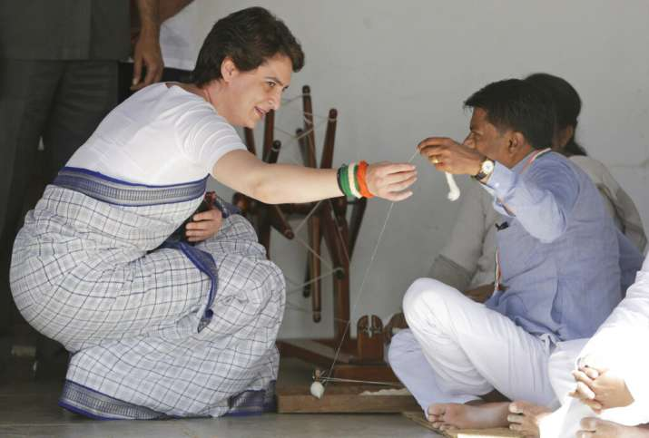 India Tv - Priyanka Gandhi Vadra, left, tries her hands at a spinning wheel at Sabarmati Ashram, which was home to Mahatma Gandhi, in Ahmedabad.