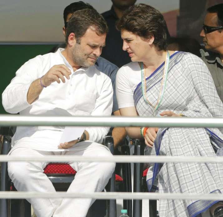 India Tv - Congress party President Rahul Gandhi left, speaks with Priyanka Gandhi Vadra during the public meeting.