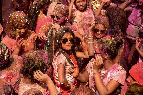 India Tv - Girls dance as they celebrate Holi festival in Guwahati