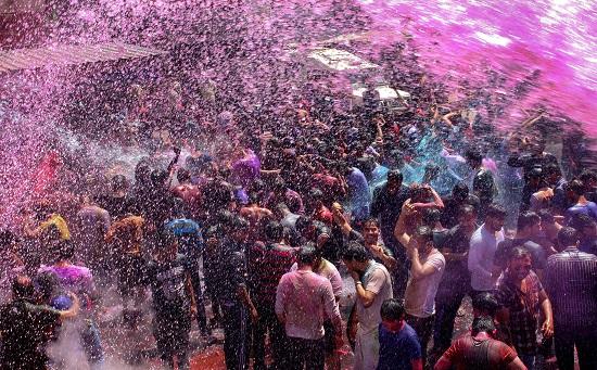 India Tv - Revellers celebrating Holi in Bhopal