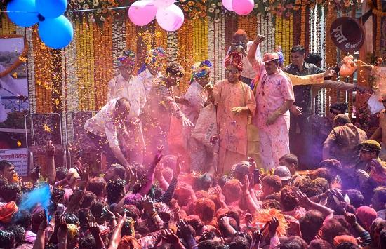India Tv - Uttar Pradesh Chief Minister Yogi Adityanath addresses the gathering during Lord Narasimha Yatra on the occasion of holi festival, in Gorakhpur
