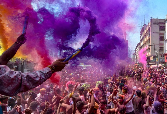 People play with colours on the occasion of Holi festival