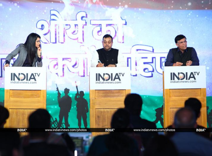 Pawan Khera and Sambit Patra in a debate at India TV