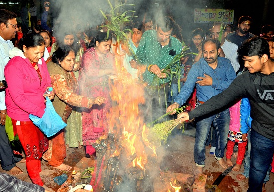India Tv - People participate in 'Holika Dahan' as part of Holi celebrations.
