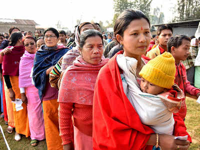 People standing in a queue to cast their votes in Manipur