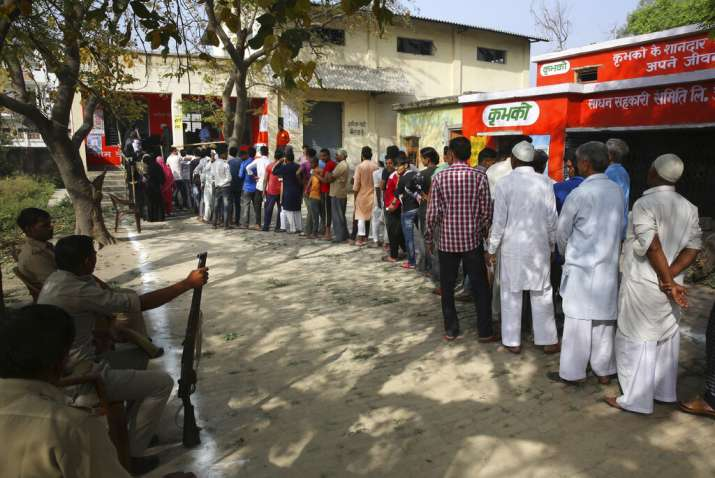 India Tv - Voters stand in a queue to cast their votes at a Polling booth for the first phase of general elections, near Ghaziabad