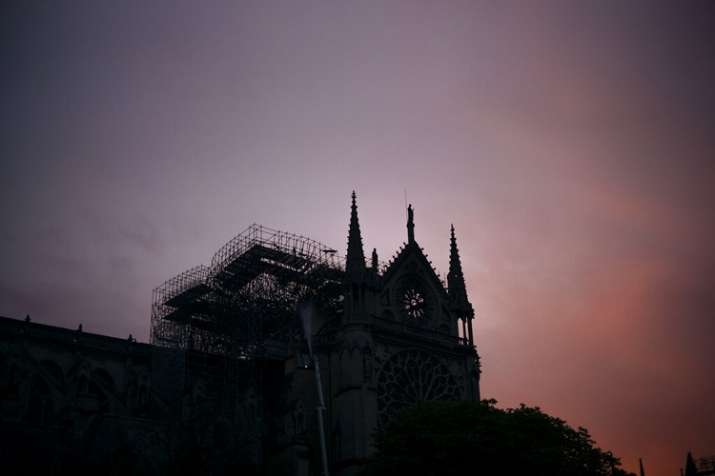 The Notre Dame cathedral is seen on sunrise after the fire