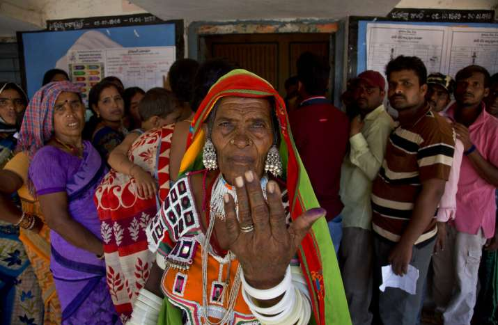India Tv - An Indian Lambada tribal woman shows the indelible ink mark on her index finger after casting her vote at a polling boothduring the first phase of general elections in Hyderabad.