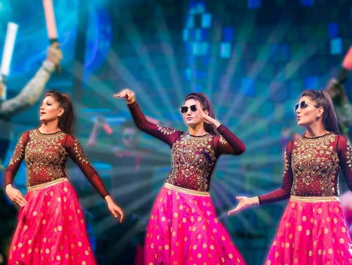 India Tv - Sapna Choudhary giving stage performance and dancing on her songs.