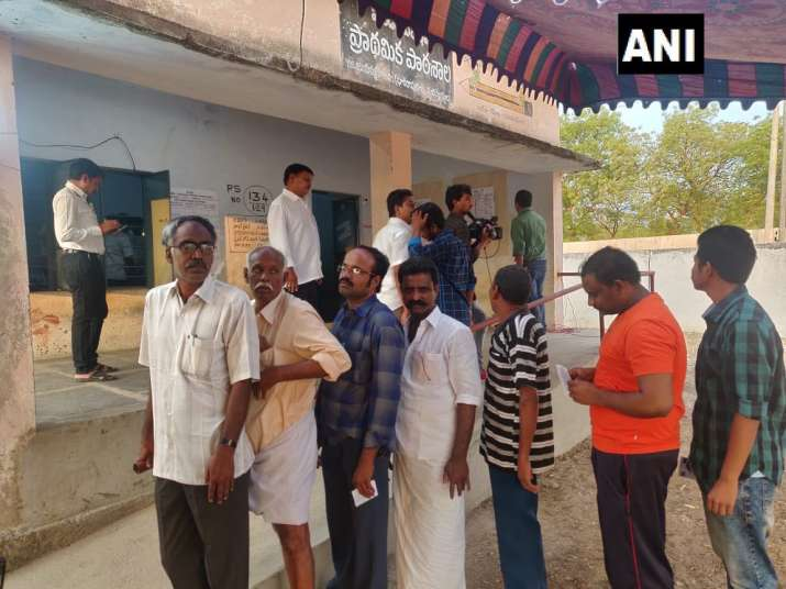 India Tv - Andhra Pradesh: Voters queue outside polling booth no 134 in Pulivendula, ahead of voting for the first phase Lok Sabha Elections 2019.
