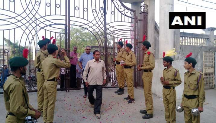 India Tv - Baghpat: Flower petals being showered and dhol being played to welcome voters at polling booth number 126 in Baraut.