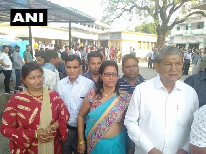 India Tv - Uttarakhand: Former Chief Minister Harish Rawat queues up to vote for the Lok Sabha Elections 2019.