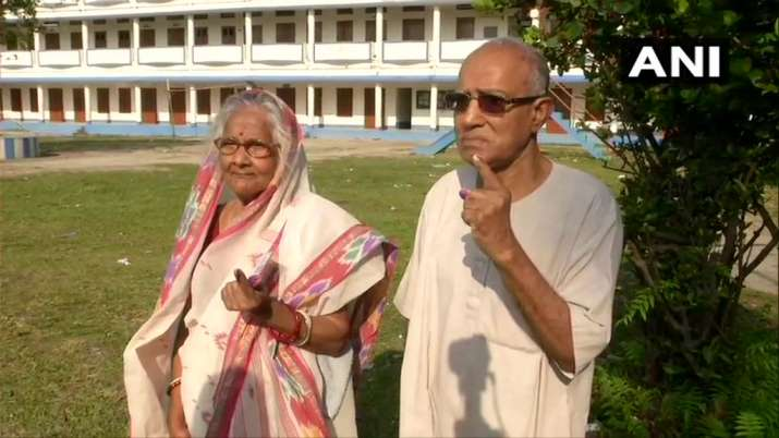India Tv - West Bengal: Senior citizen voters cast their vote at a polling booth in Coochbehar.