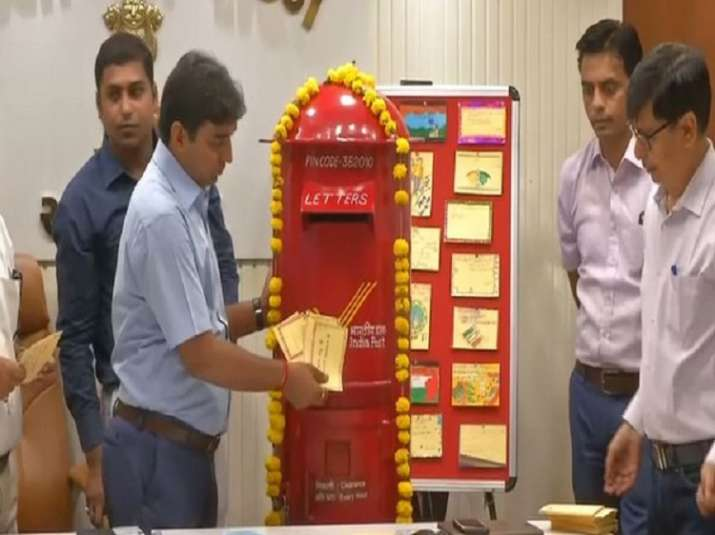 DC Vikrant Pandey sending out postcards through India Post