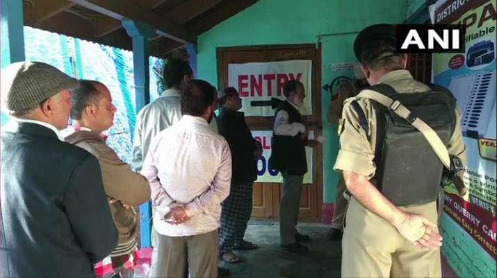 India Tv - Jammu & Kashmir: People queue up outside polling station in Doda under Udhampur