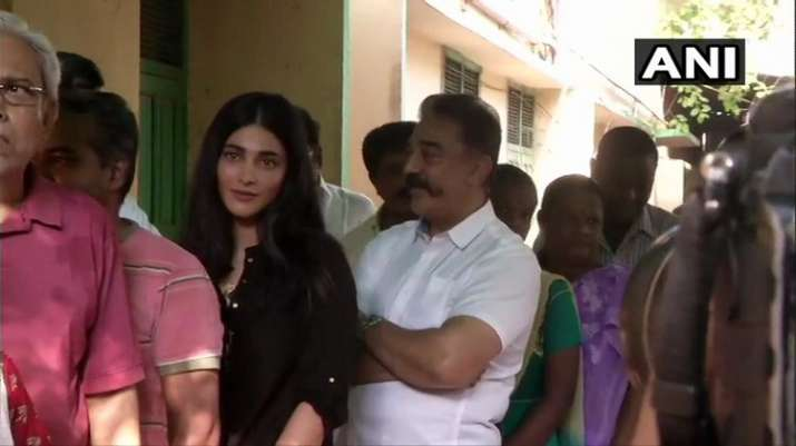 India Tv - Makkal Needhi Maiam chief Kamal Haasan and his daughter Shruti Haasan queue up outside polling station at Alwarpet Corporation School in Chennai to cast their votes.