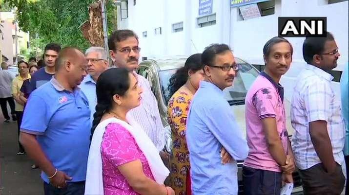 India Tv - Karnataka: People queue up outside polling stations in Girinagar area of Bangalore South
