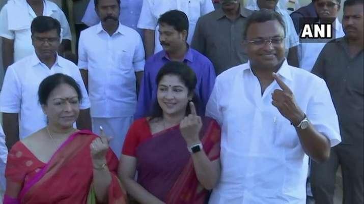 India Tv - Nalini Chidambaram, Karti Chidambaram and his wife Srinidi Rangarajan casts their vote at a polling station in Karaikudi, Sivaganga.