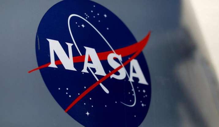 NASA spots ravioli-like moons nestled in Saturn's rings