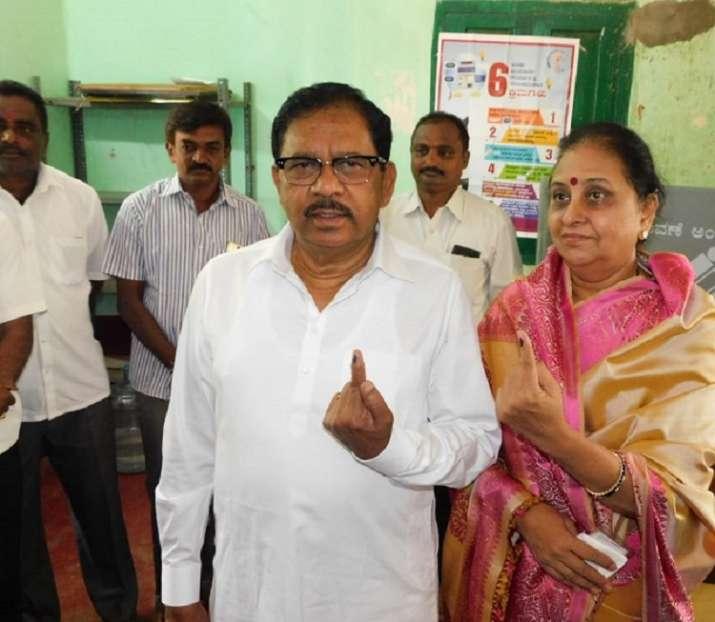 India Tv - Karnataka: Deputy CM G Parameshwara and his wife Kannika Parameshwari cast their vote at a polling booth in Koratagere, Tumkur.