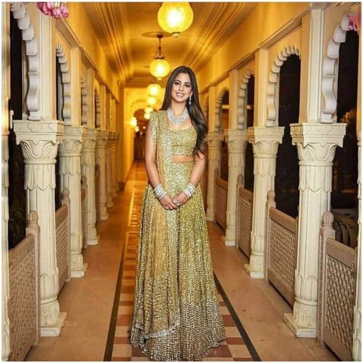India Tv - Isha Ambani in golden lehenga
